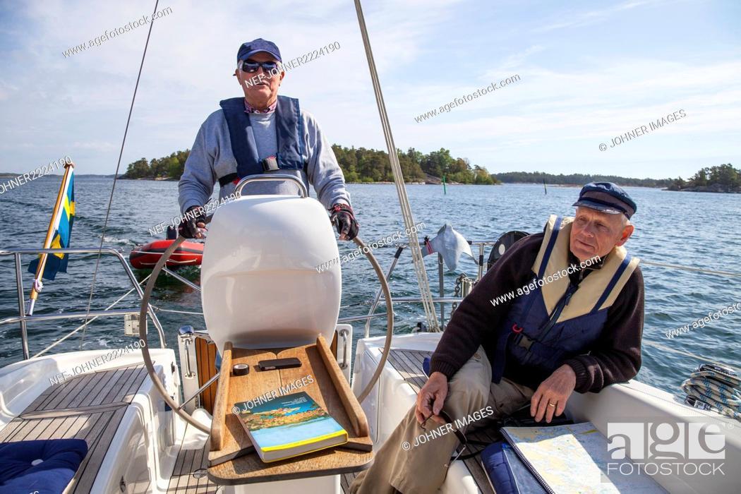 Stock Photo: Senior men on boat.