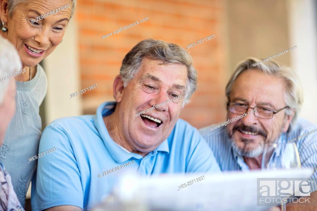 Stock Photo: Two senior couples having fun together.