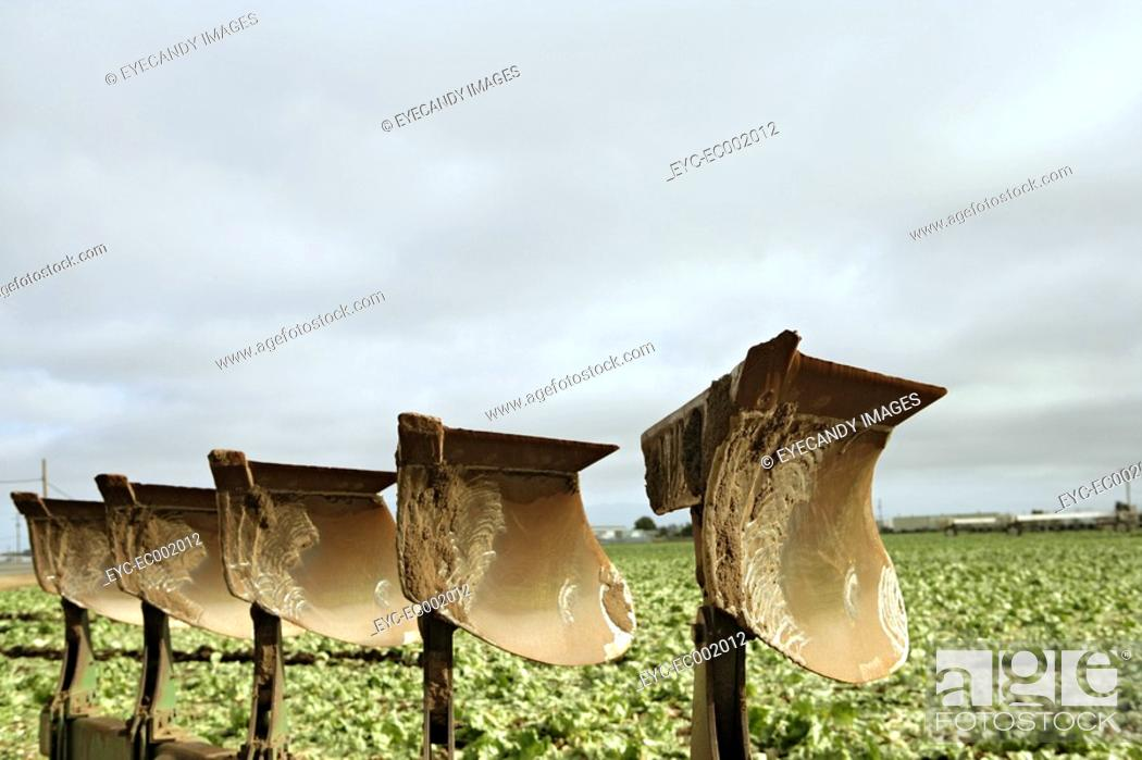 Stock Photo: View of sharp blades on an agriculture lands.