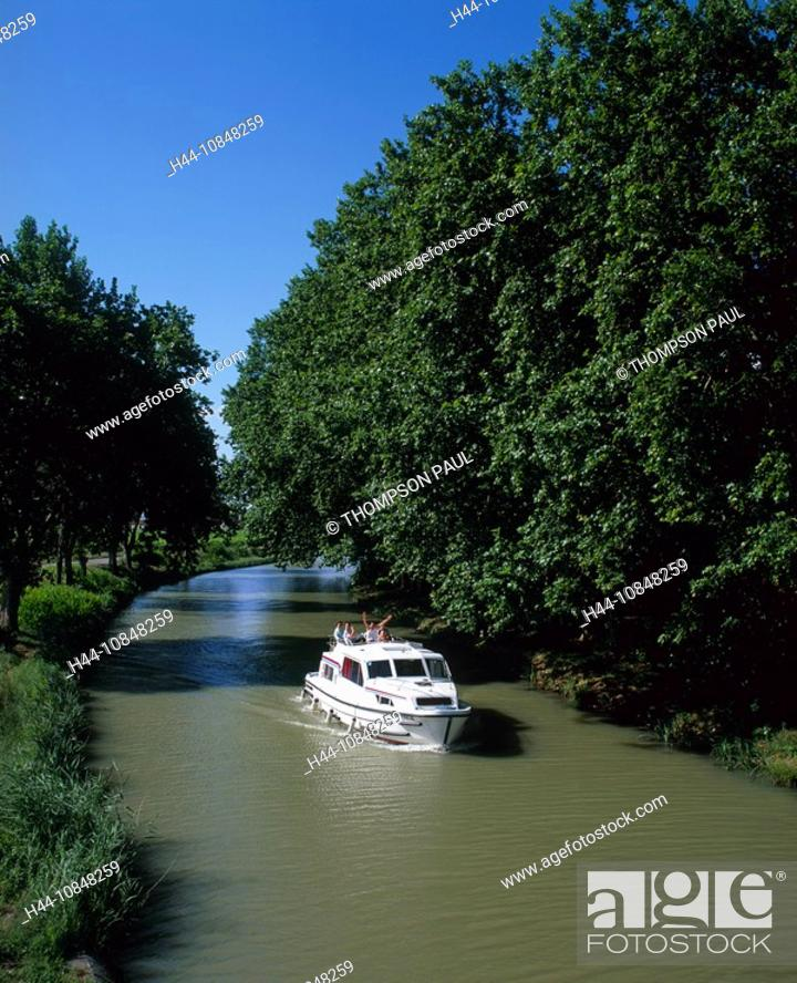 Stock Photo: France, Europe, Canal du midi, motor, Boat, family, holiday, sailing, down, French, countryside, Aude, Languedoc, Rous.