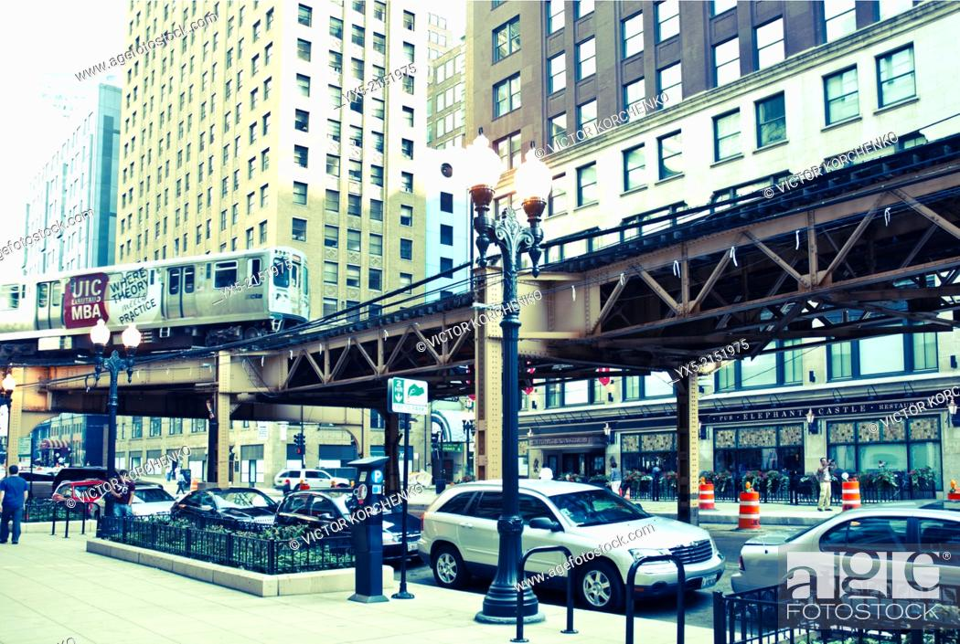 Stock Photo: Loop train riding above a street in Chicago.