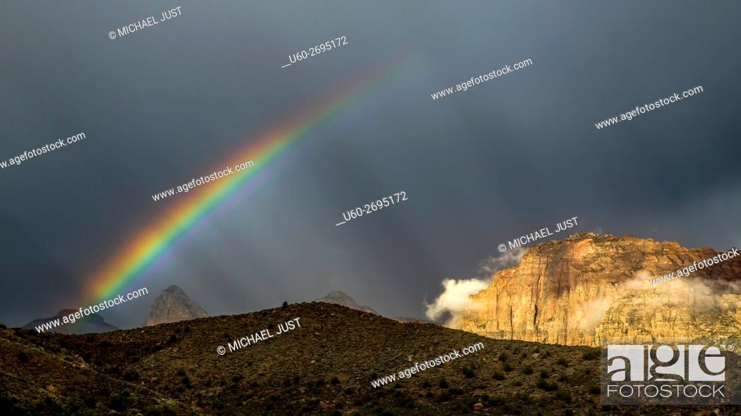 Stock Photo: A passing thunderstorm produces a rainbow at Zion National Park, Utah.