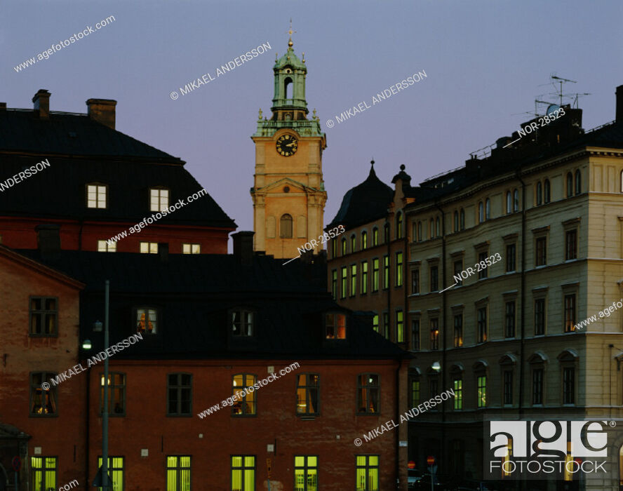 Stock Photo: A clock tower in a city.