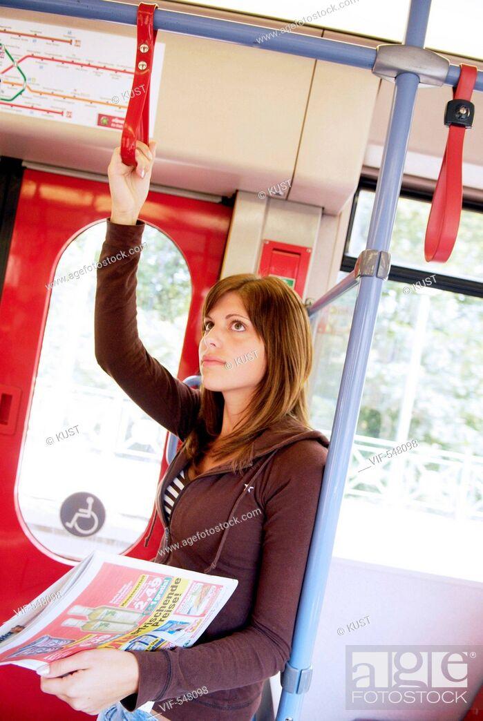 Stock Photo: Frau faehrt in der U-Bahn. - Austria, 25/07/2007.