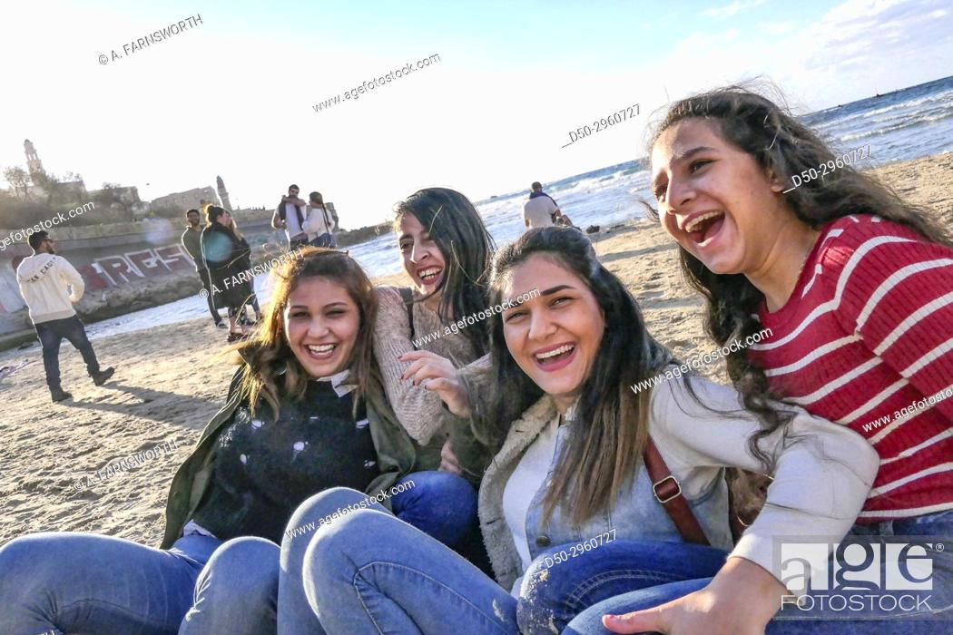 Photo de stock: TEL AVIV ISRAEL Young Arab girls hamming it up for the photographer on the beach.