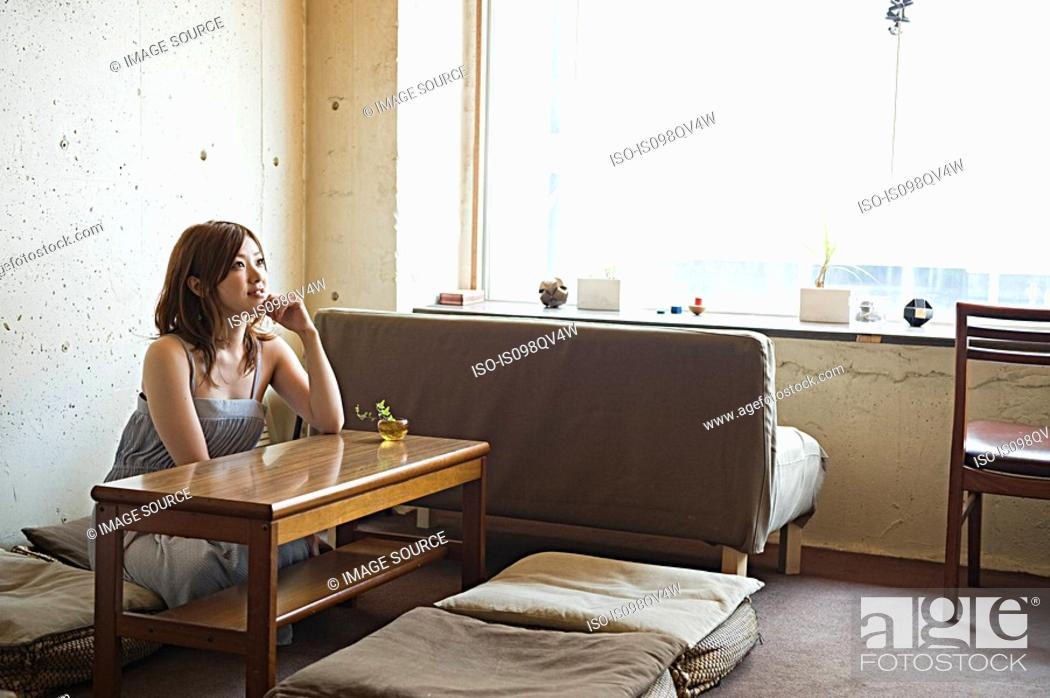 Stock Photo: Young woman in room.
