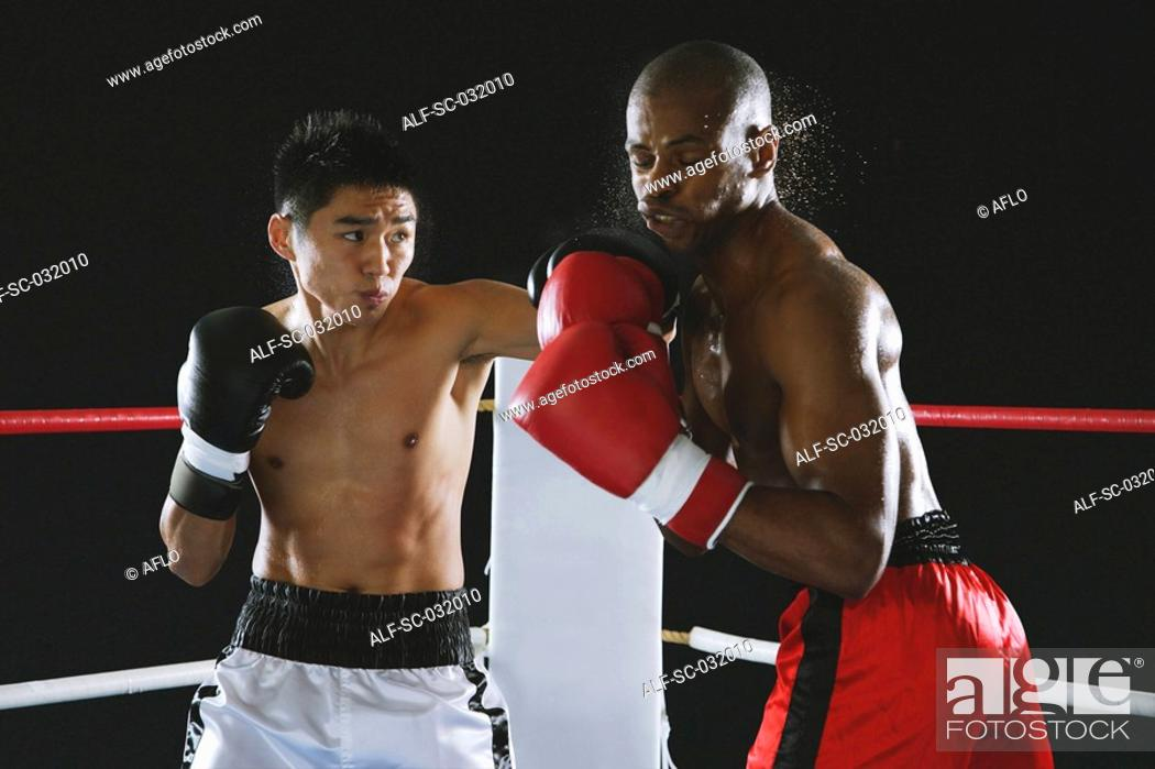 Stock Photo: Japanese boxer punching to his opponent.