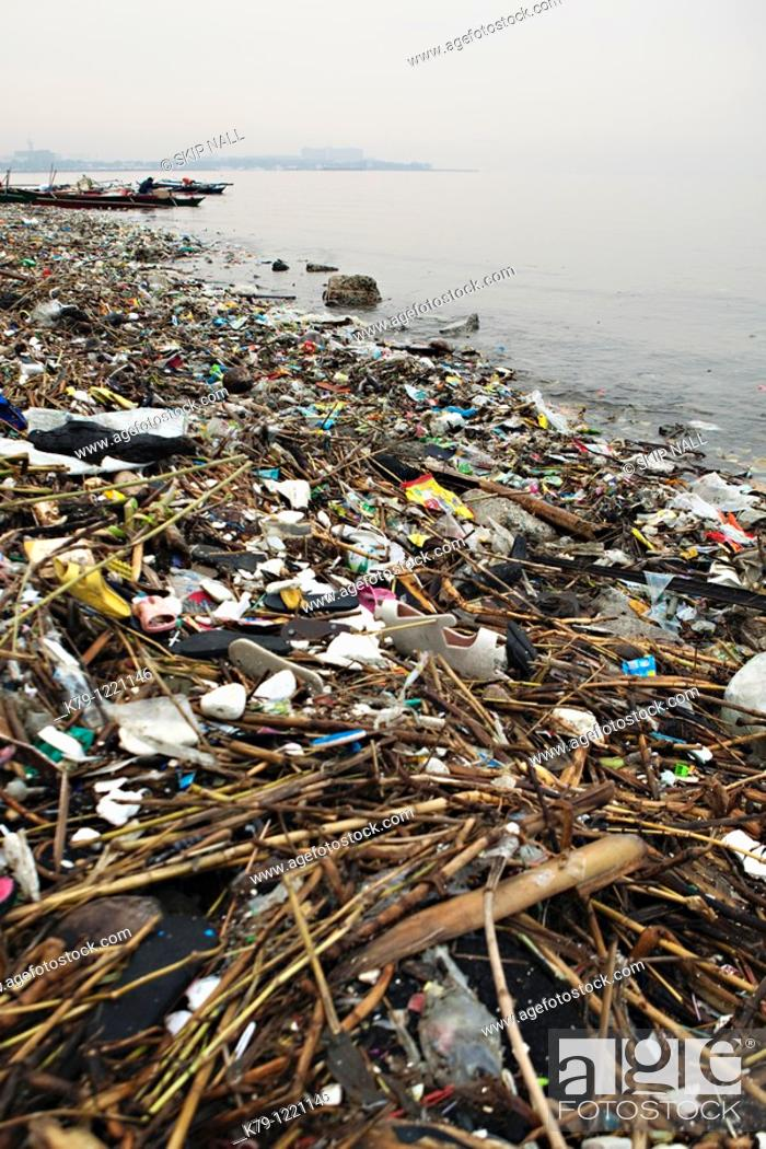 Stock Photo: Debris on the shore if Manila Bay.