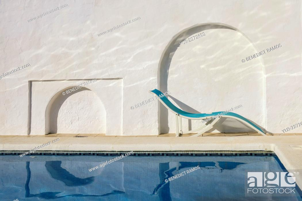 Stock Photo: Swimming pool with recliner.