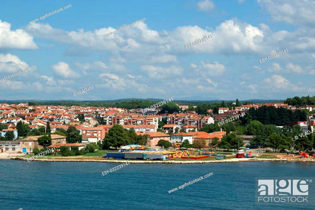Stock Photo: The roofs of the city on a sunny summer day, Porec, Croatia.