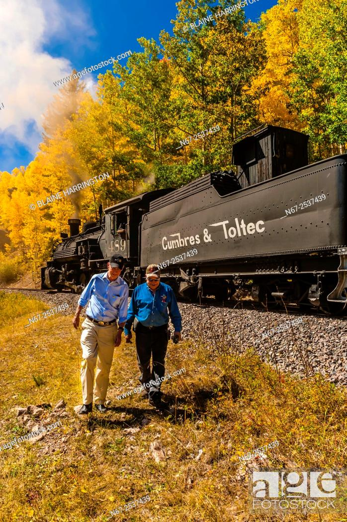 Stock Photo: Governor John Hickenlooper of Colorado walking with C&TSRR Railroad Superintendent Marvin Casias, who has been with the C&TSRR since the day it started in 1970.