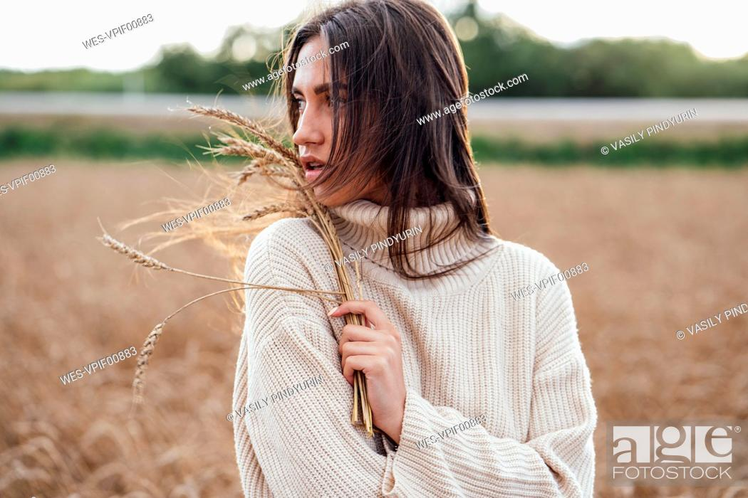 Stock Photo: Portrait of young woman with ears wearing oversized turtleneck pullover.