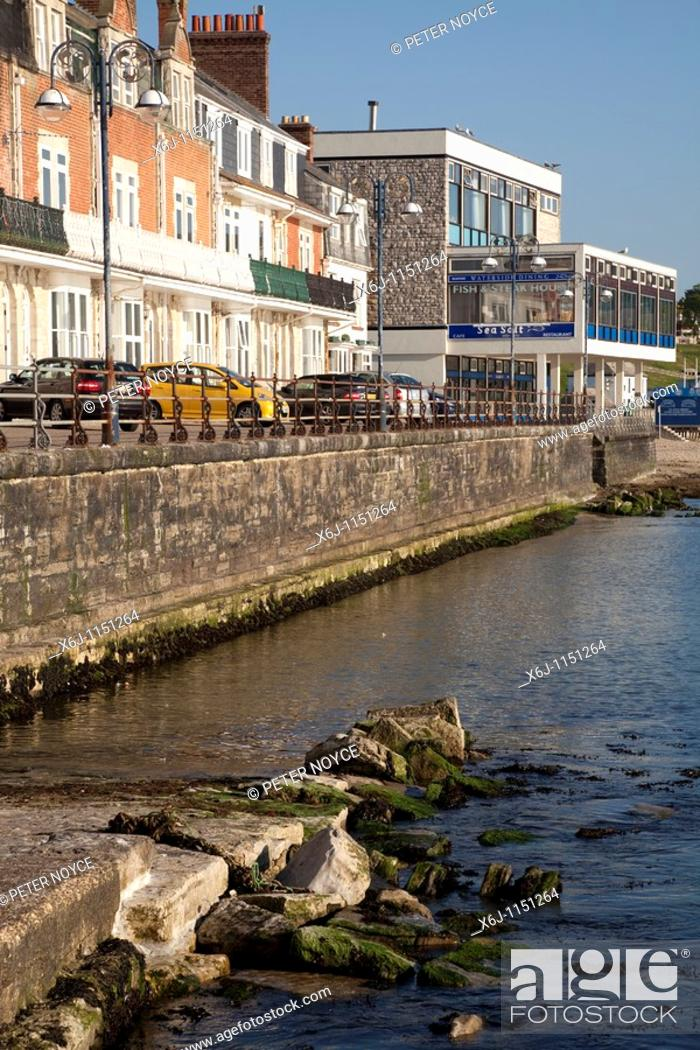 Stock Photo: promenade, sea wall, slipway and stone groynes at Swanage in the early morning sunshine.