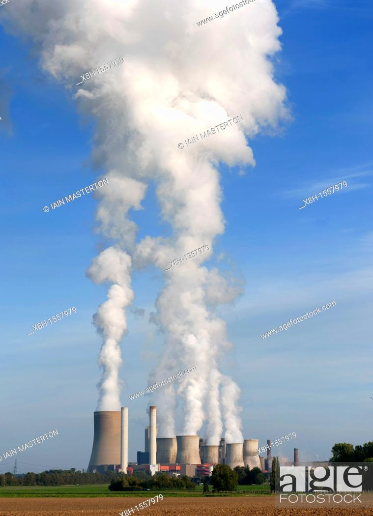 Stock Photo: View of emissions from Niederaussem coal fired power station in Bergheim district of North Rhine Westfallen Germany.