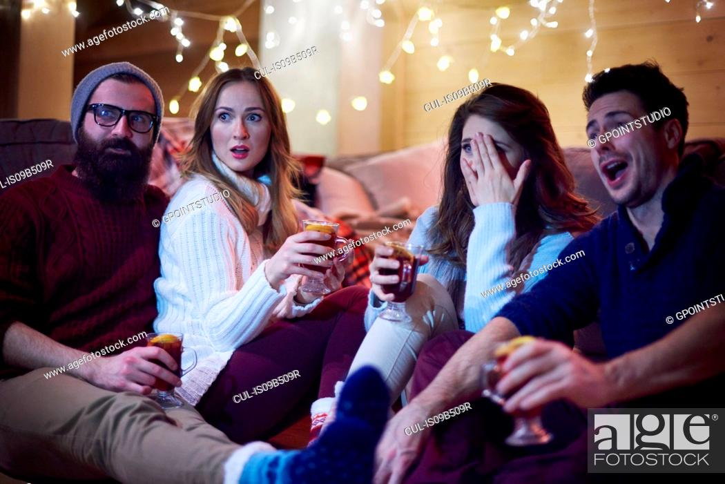 Stock Photo: Friends enjoying mulled wine in chalet.