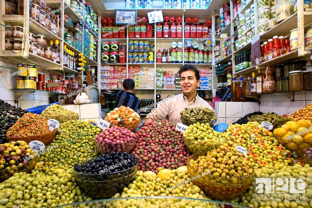 Stock Photo: Morocco, Tangier Tetouan Region, Tangier, Medina, grocer selling olives.