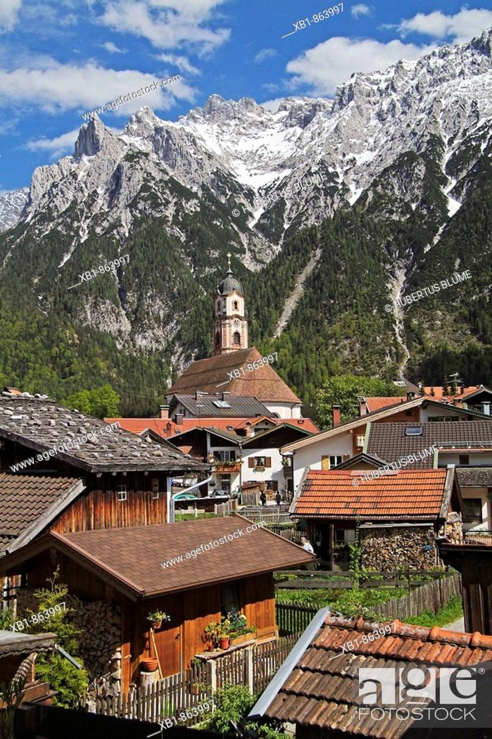Stock Photo: Mittenwald with the Church of Saints Peter and Paul, in the back Karwendel mountains, district Garmisch-Partenkirchen, Upper Bavaria, Bavaria, Germany.