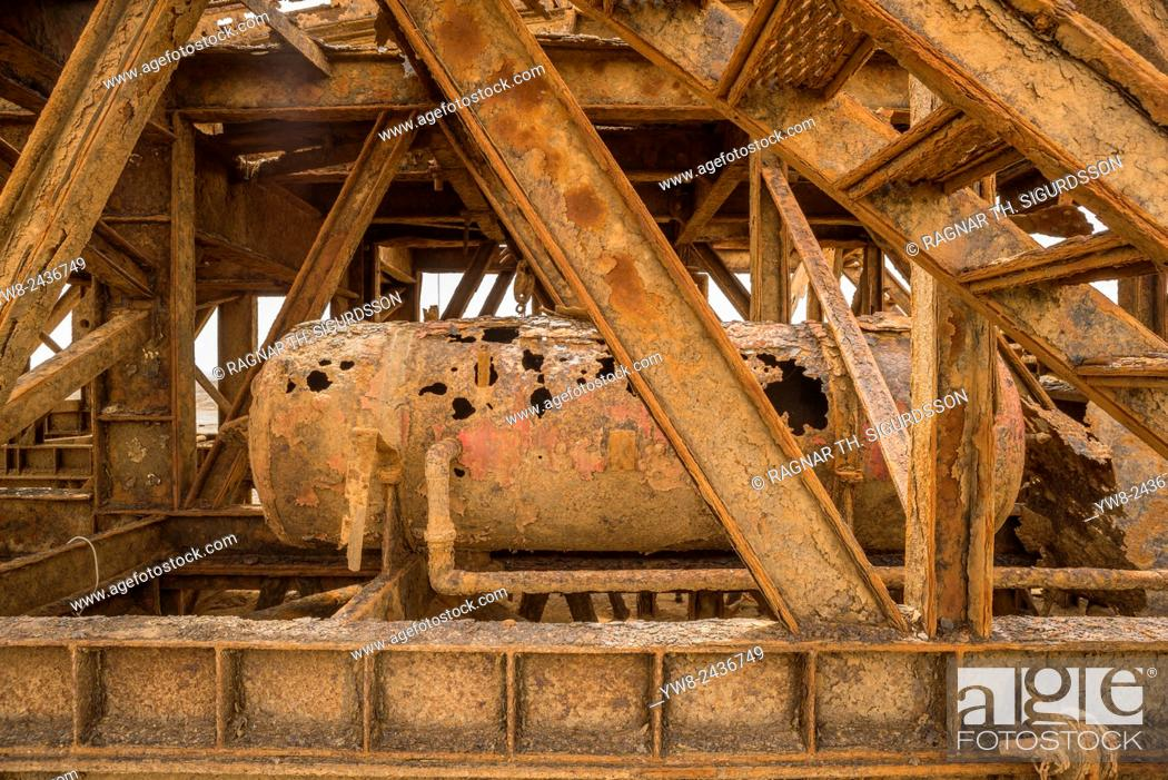 Stock Photo: Rusting oil rig abandoned in the desert, Skeleton Coast, Namibia, Africa.