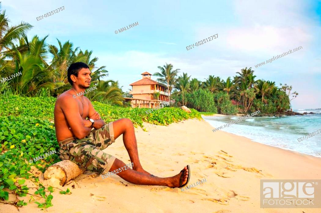 Stock Photo: A young dark-skinned guy on the ocean.