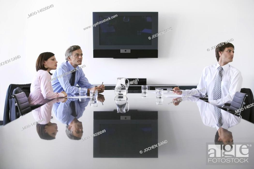 Stock Photo: Three business colleagues in conference room.