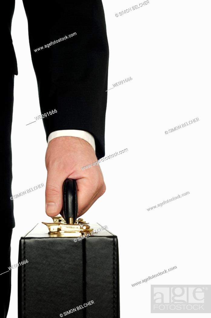 Stock Photo: Businessman Carrying a Briefcase Close Up, Against a White Background.