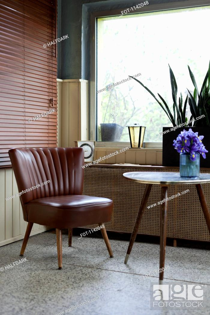 Stock Photo: A vintage style chair and table.