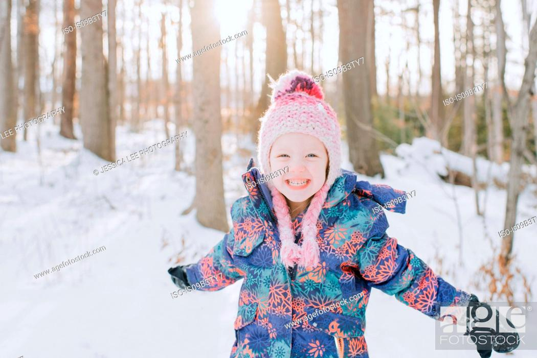 Stock Photo: Girl playing in snow, Peterborough, Ontario.