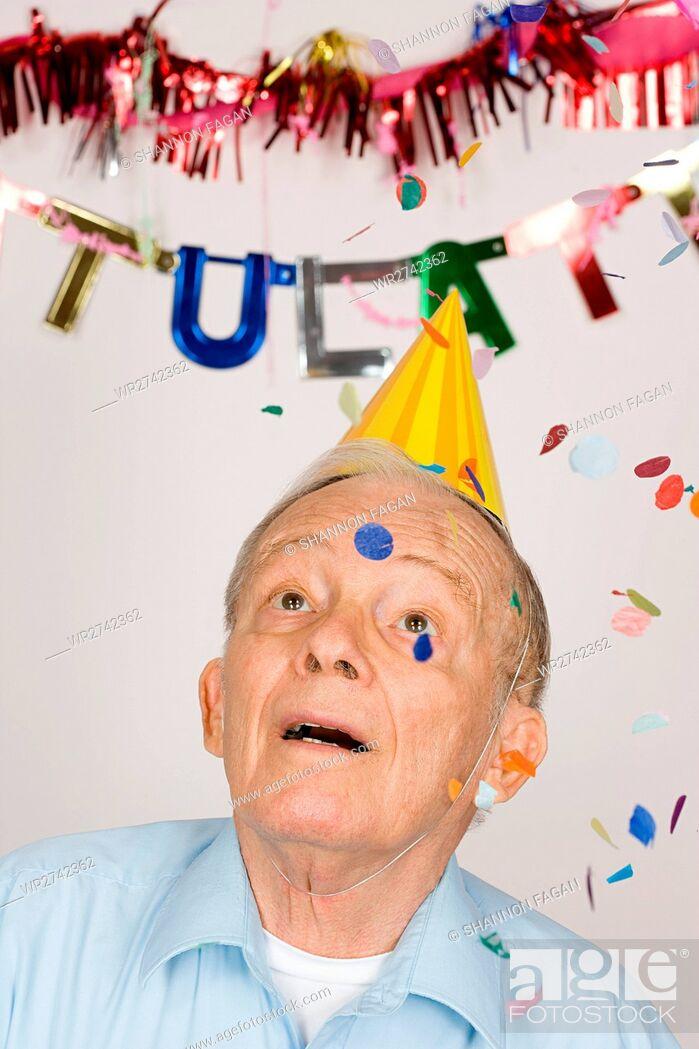 Stock Photo: Senior man at a party.