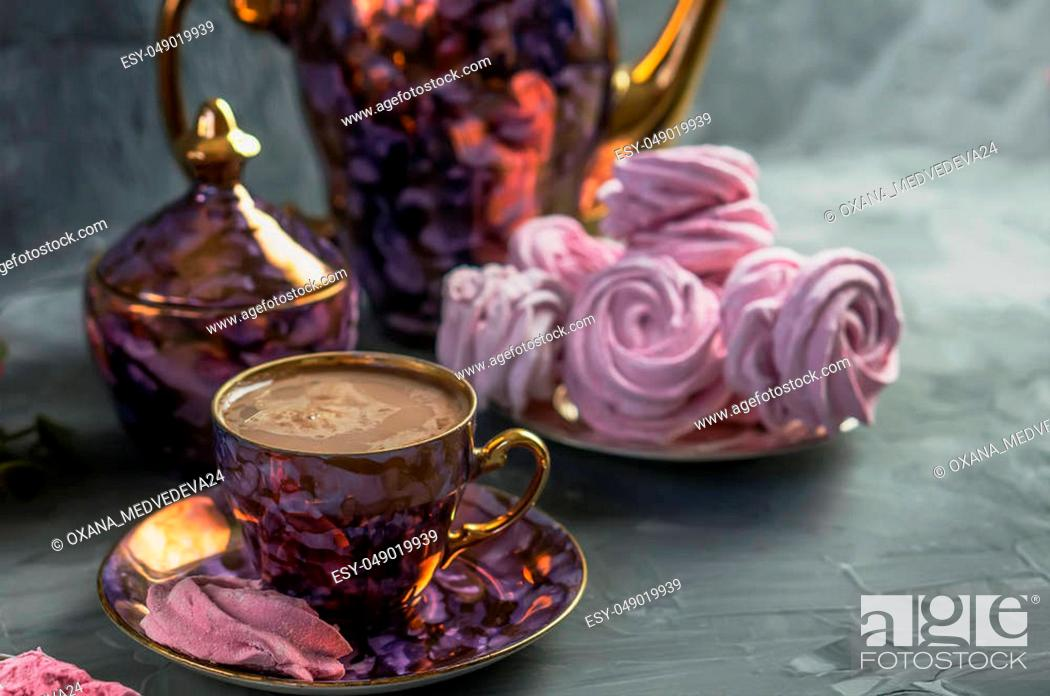 Stock Photo: Hot chocolate in a beautiful Golden Cup with a pink marshmallow home made.