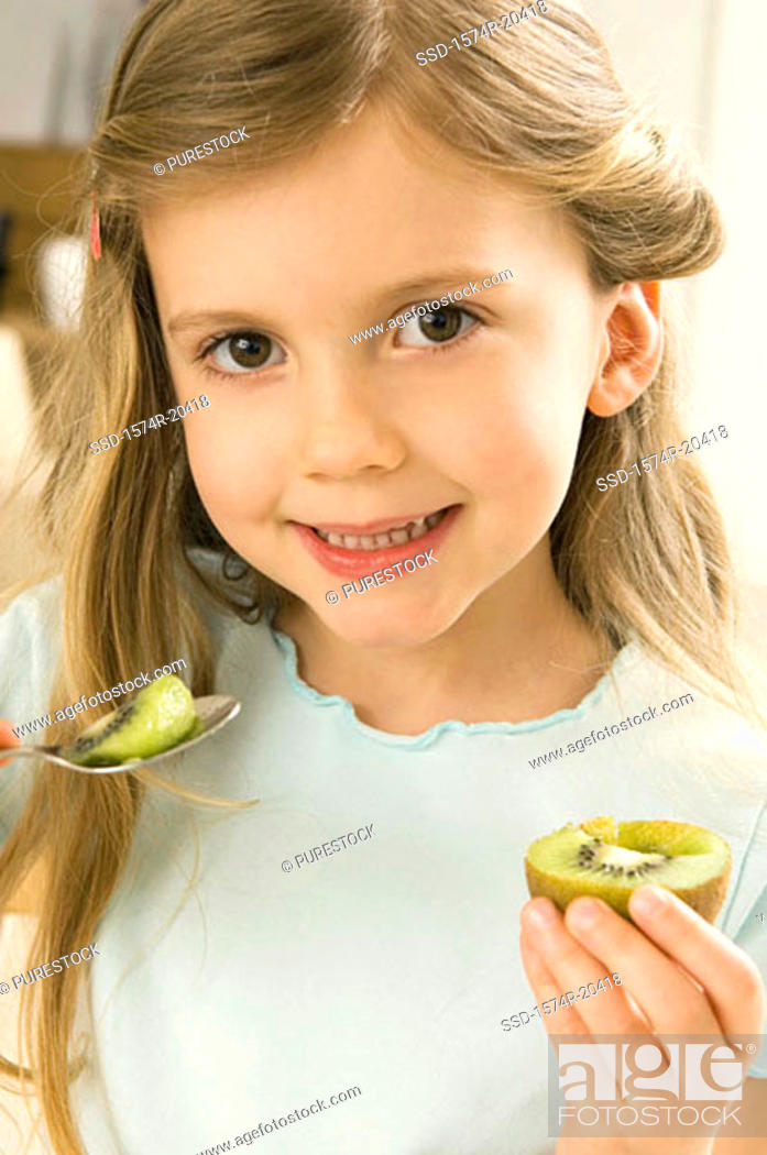 Stock Photo: Portrait of a girl holding a kiwi.