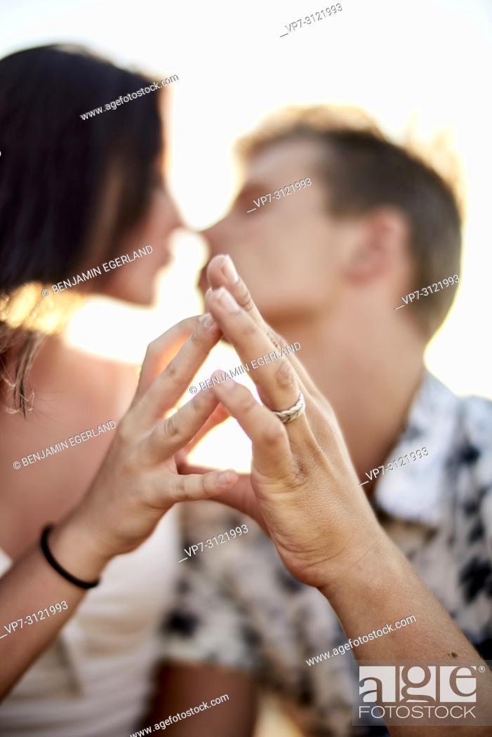 Stock Photo: Sensual couple touching fingers, love, emotions, relationship, flirting. Chersonissos, Crete, Greece.