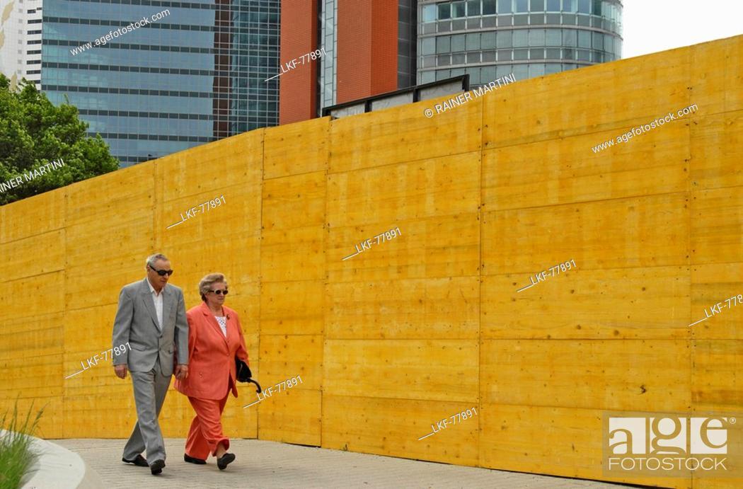 Stock Photo: An older couple walking in Uno City, Vienna International Centre, Vienna, Austria.
