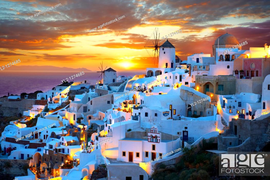 Stock Photo: Oia  Ia  Santorini - Windmills and town at sunset, Greek Cyclades islands - Photos, pictures and images.