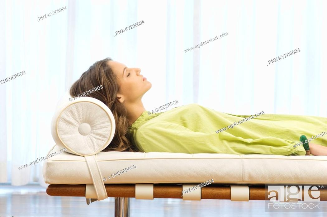 Stock Photo: Woman lying on the bed.