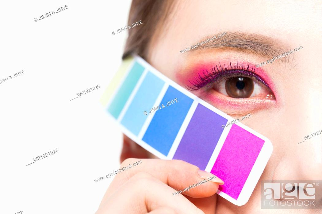 Stock Photo: a woman with a make up scale.