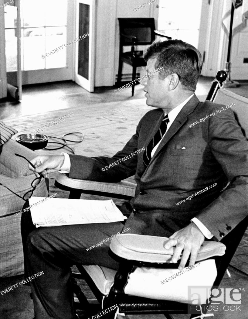 Stock Photo - President John Kennedy in his Oval Office rocking chair. The chair relieved tension in JFKu0027s injured lower back by keeping the muscles moving.  sc 1 st  Age Fotostock & President John Kennedy in his Oval Office rocking chair Stock Photo ...