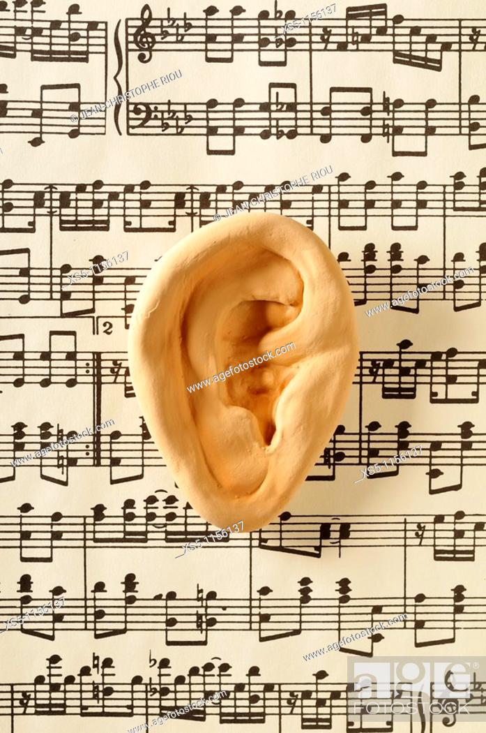 Stock Photo: ear and music.