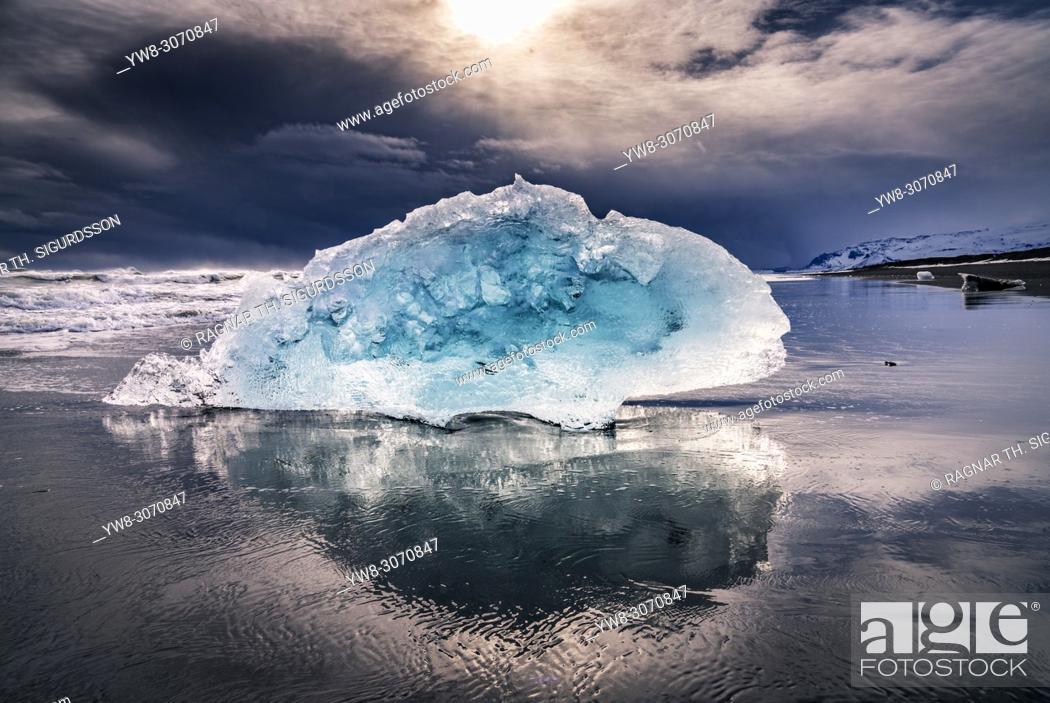 Stock Photo: Glacial ice on a black sand beach, Breidamerkurfjara beach, Vatnajokull Ice Cap, Iceland. Large chucks of ice calve off of the Breidamerkurjokull and then wash.