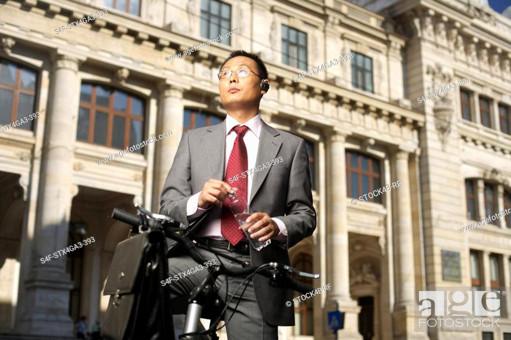 Stock Photo: Businessman on a bike.