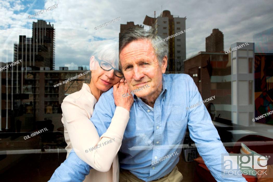 Stock Photo: Couple looking through window.