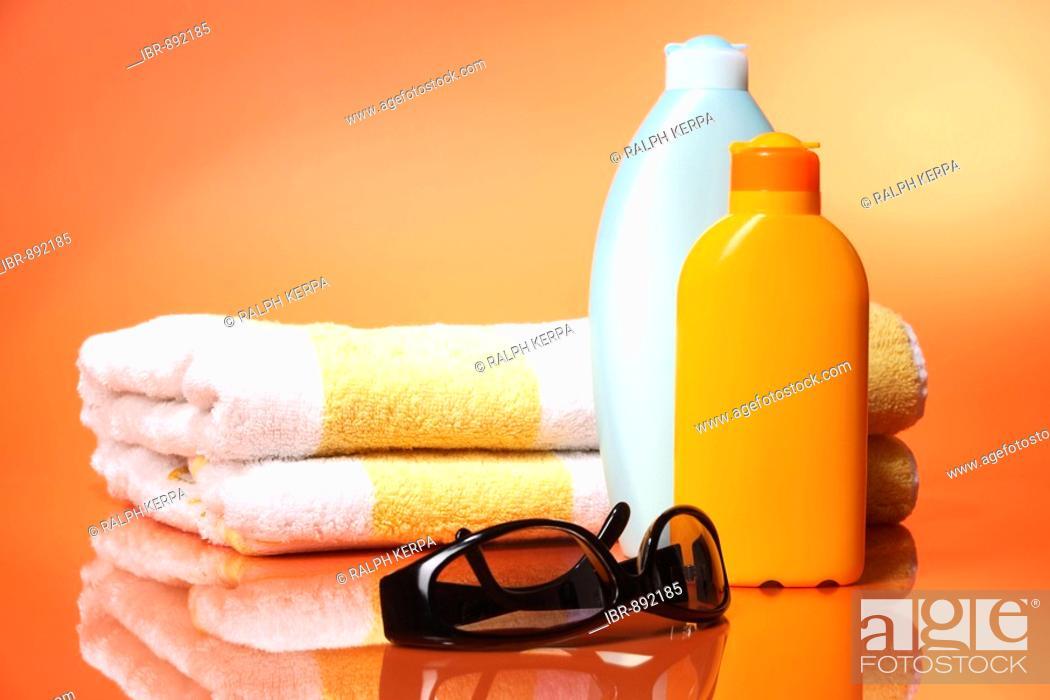 Stock Photo: Sunglasses, towel and sun milk.