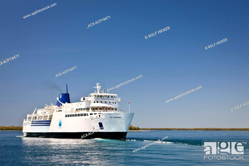 Stock Photo: Chi-Cheemaun passenger and vehicle ferry departing Tobermory on the Bruce Peninsula for Manitoulin Island on Lake Huron, Ontario, Canada.