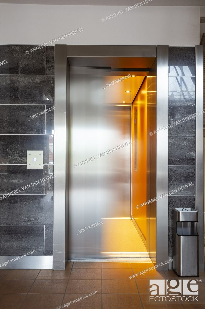 Stock Photo: Building Elevator with moving door in apartment complex luxury silver.