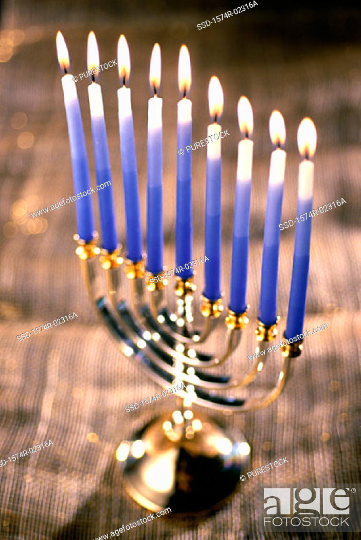 Stock Photo: Close-up of lit candles on a menorah.