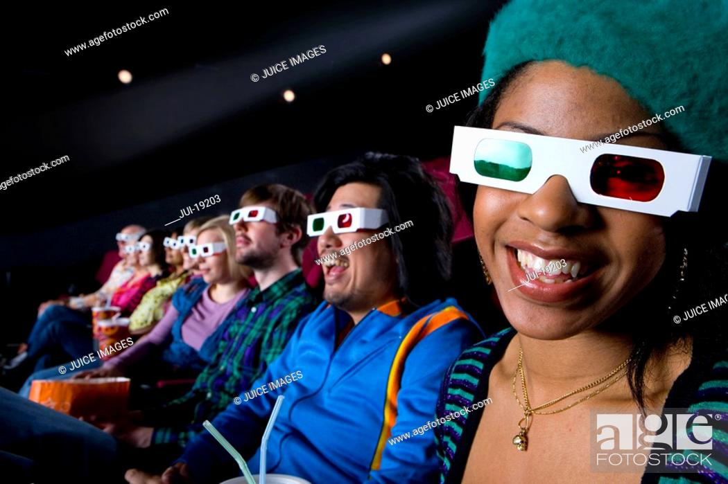 Stock Photo: Audience in cinema wearing 3D glasses, smiling, portrait.