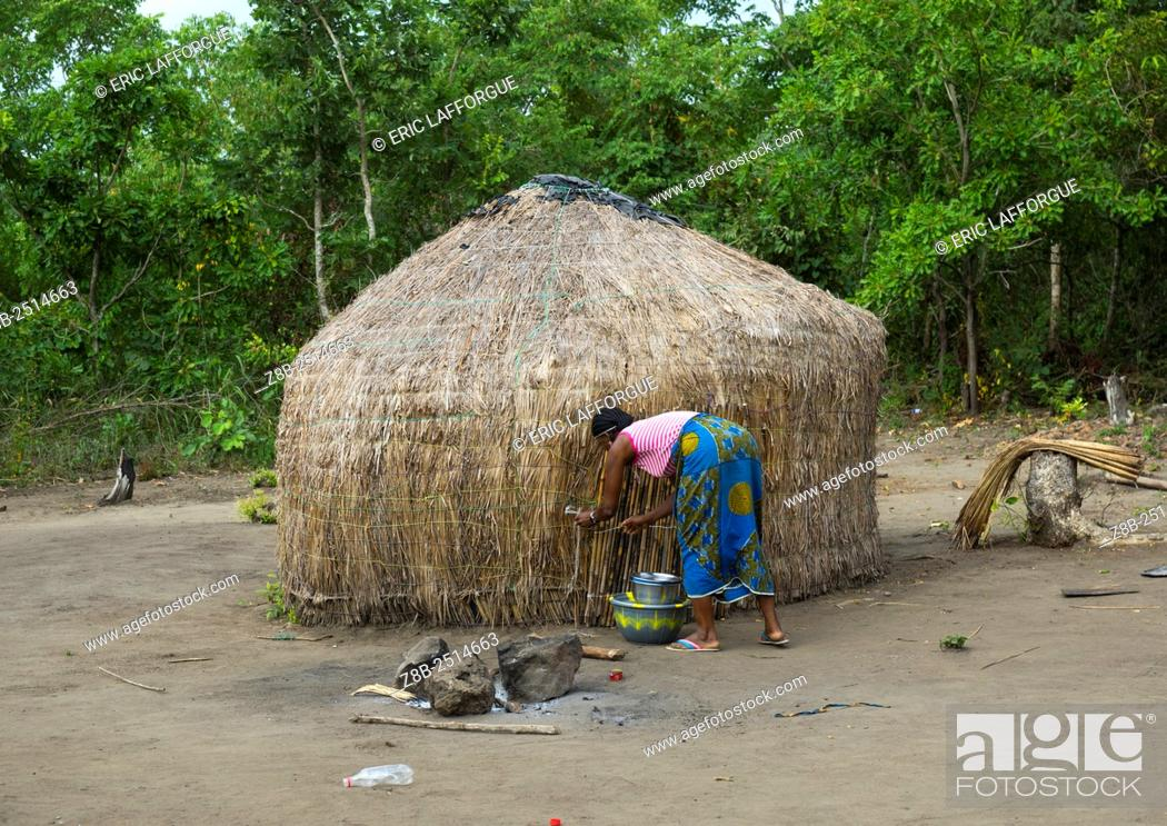 Stock Photo: Benin, West Africa, Gossoue, fulani peul woman in front of her hut.
