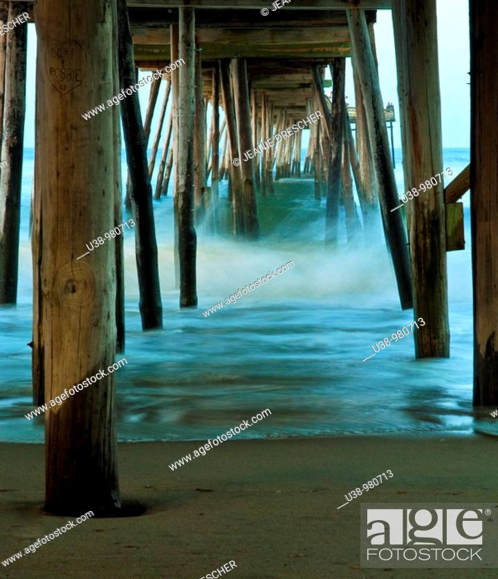 Stock Photo: Waves under the Avalon Pier, Outer Banks, North Carolina during a hurricane.
