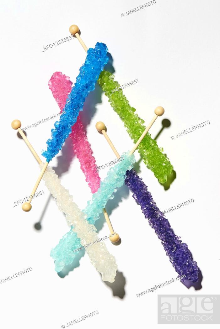 Stock Photo: Various sugar sticks on a white surface.