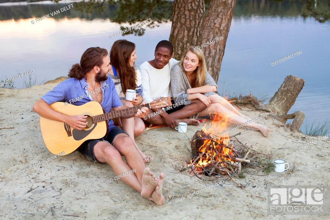 Stock Photo: Couples camping by lake.