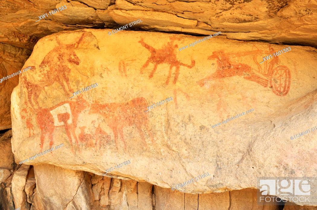 Imagen: neolithic rockart with a rare display of a chariot of the garamantes, Adrar Tekemberet, Immidir, Algeria, Sahara, North Africa.